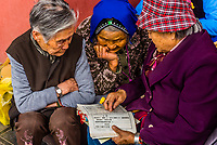 Elderly Chinese women reading prayer books, Yuantong Temple is the most famoust Buddhist temple in Kunming, Yunnan Province, China. It was first built in the late 8th and early 9th century, the time of the Nanzhao Kingdom in the Tang dynasty.