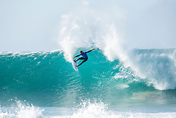 Rookie Frederico Morais of Portugal advances to Round Four of the Corona Open J-Bay after defeating fellow rookie Connor O'Leary of Australia in Heat 4 of Round Three in pumping overhead conditions at Supertubes, Jeffreys Bay, South Africa.