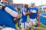 Dec 1, 2012; Tulsa, Ok, USA; Tulsa Hurricanes tailback Willie Carter (34) and quarterback Cody Green (7) react following a game against the University of Central Florida Knights at Skelly Field at H.A. Chapman Stadium. Tulsa defeated UCF 33-27 in overtime to win the CUSA Championship. Mandatory Credit: Beth Hall-USA TODAY Sports