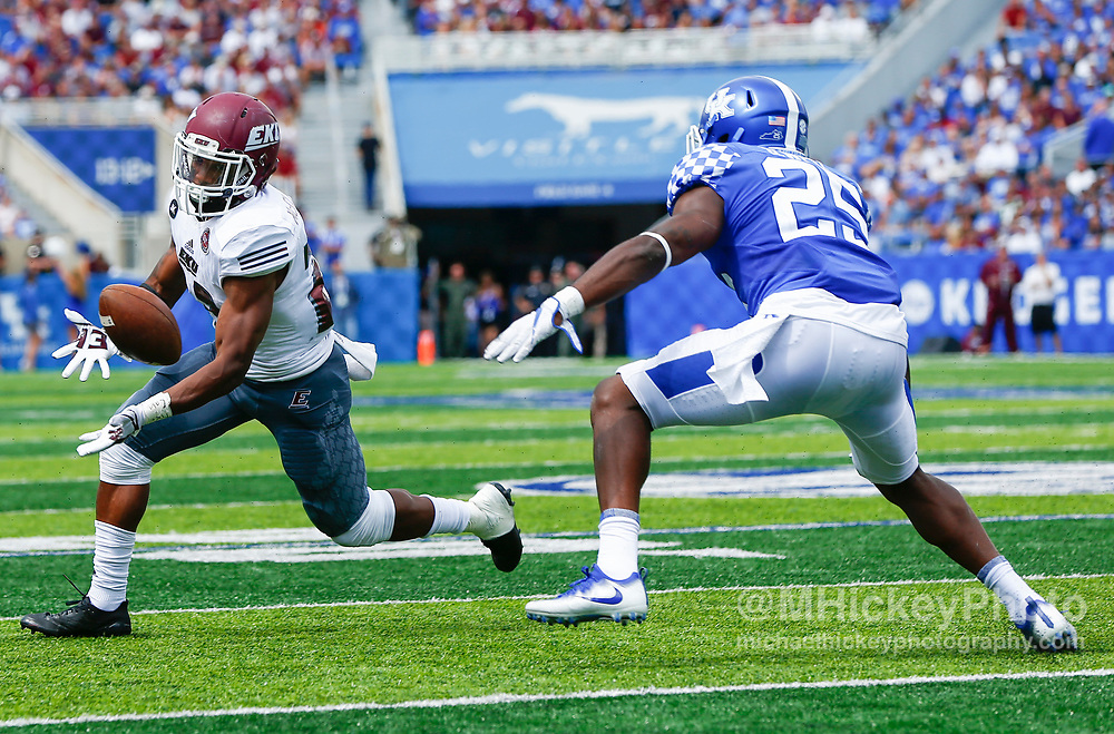LEXINGTON, KY - SEPTEMBER 09: Daryl McCleskey Jr. #23 of the Eastern Kentucky Colonels tries to hang on to the pass as Darius West #25 of the Kentucky Wildcats defends at Kroger Field on September 9, 2017 in Lexington, Kentucky. (Photo by Michael Hickey/Getty Images) *** Local Caption *** Daryl McCleskey Jr.; Darius West