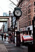 CS02161. Reingold street clock. Reingold's jewelers. 504 SW Fourth. corner of Washington. February 1976