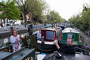 Mcc0095075 . Daily Telegraph<br /> <br /> DT News<br /> <br /> <br /> Narrow boat residents on the Regents Canal in Little Venice clap for the NHS <br /> <br /> London 23 April 2020