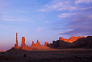 Sunset lingers on Yei-bi-Chei & Totem Pole, Monument Valley, Arizona.©1996 Edward McCain. All rights reserved. McCain Photography, McCain Creative, Inc..