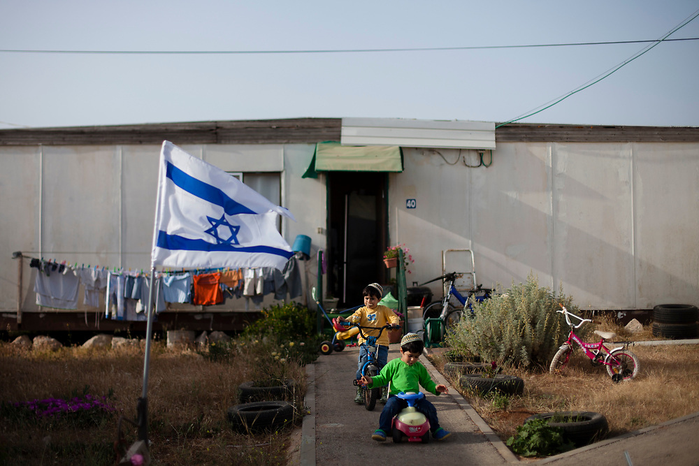 Jewish children play outside their home at the Jewish settlement of Efrat  in Gush Etzion, near the Palestinian West Bank town of Bethlehem, on May 2, 2012.