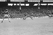 Dublin player falls to the ground as Galway kicks the ball during the All Ireland Senior Gaelic Football Championship Final Dublin V Galway at Croke Park on the 22nd September 1974. Dublin 0-14 Galway 1-06.