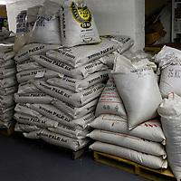 Canada, Nova Scotia, Guysborough. Bags of Hops and Grains at Microbrewery.