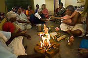 Srinivasan officiates as Pandit during a puniyathanam (remebrance ceremony) for Sunderajan in his room where he died. Tamaraikulum Elders village, Tamil Nadu, India