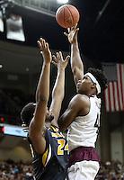 Texas A&M's Tavario Miller (42) makes a short jump shot over Missouri's Kevin Puryear (24) during an NCAA college basketball game, Saturday, Jan. 23, 2016, in College Station, Texas.  Texas A&M won 66-53.  (AP Photo/Sam Craft)