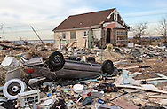 Union Beach NJ, November 16, Car upside down next to a home destroyed by superstorm Sandy's surge, that damaged over 200 homes in Union Beach alone. Hurricane Sandy's strength is being blamed on climate change by many scientists.
