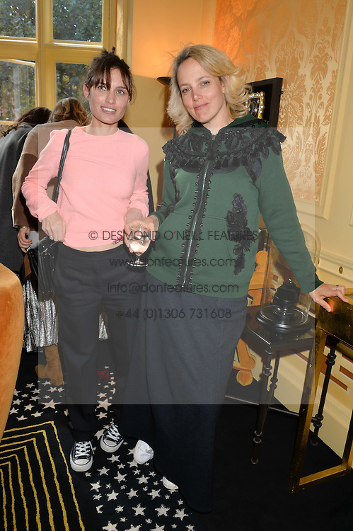 Left to right, SHEHERAZADE GOLDSMITH and BAY GARNETT at a lunch to view Solange Azagury-Partridge's new collection - Chromance at her store at 5 Carlos Place, London on 7th October 2014.