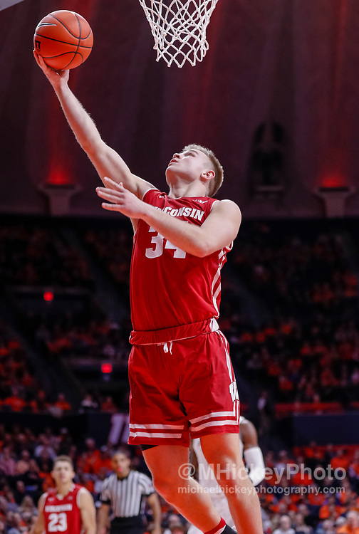 CHAMPAIGN, IL - JANUARY 23: Brad Davison #34 of the Wisconsin Badgers shoots the ball during the game against the Illinois Fighting Illini at State Farm Center on January 23, 2019 in Champaign, Illinois. (Photo by Michael Hickey/Getty Images) *** Local Caption *** Brad Davison