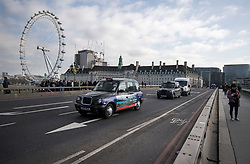 © Licensed to London News Pictures. 22/03/2018. London, UK. Vehicle pass over Westminster Bridge in London on the one year anniversary of the Westminster Bridge Terror attack in which lone terrorist killed 5 people and injured several more, in an attack using a car and a knife. The attacker, 52-year-old Briton Khalid Masood, managed to gain entry to the grounds of the Houses of Parliament and killed police officer Keith Palmer. Photo credit: Ben Cawthra/LNP