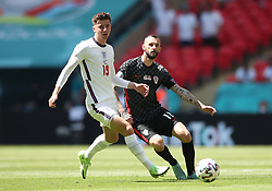 England's Mason Mount (left) and Croatia's Marcelo Brozovic battle for the ball during the UEFA Euro 2020 Group D match at Wembley Stadium, London. Picture date: Sunday June 13, 2021.