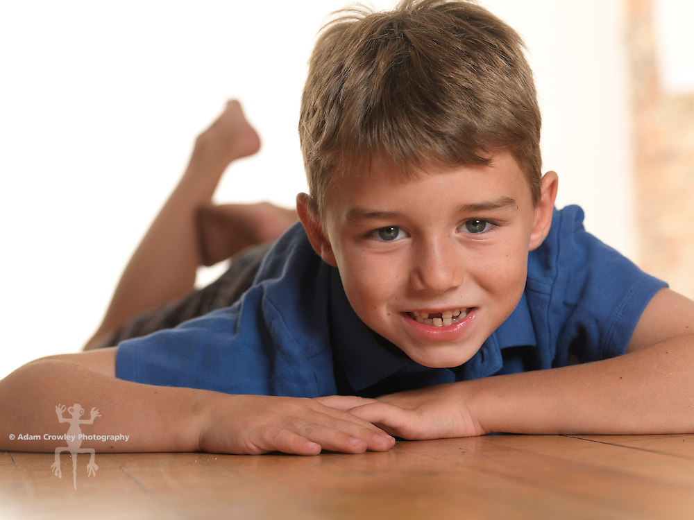 Portrait of 7 year old boy with missing front tooth