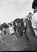 Charles Haughey Visits The Community Games. (T5)..1989..03.10.1989..10.03.1989..3rd September 1989..An Taoiseach, Charles Haughey TD,accompanied by Mr Frank Fahey, TD, Minister of State with responsibility for Youth and Sport attended the Twentieth National Finals of the Community Games at Mosney,  Co.Meath yesterday...Picture shows An Taoiseach, Charles Haughey TD,getting instruction in how to throw the javelin from competitor, Cliona Maher. Ryanair hostess Anne O'Callaghan is included in the picture.