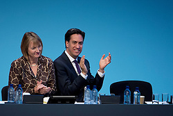 © London News Pictures. 23/09/2013 . Brighton, UK. Labour Party leader ED MILIBAND (right) and deputy party leader HARRIET HARMAN (left) listen to Ed Balls deliver a speech on the British economy on day two of the Labour Party Annual Conference in Brighton. Photo credit : Ben Cawthra/LNP
