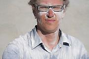 construction worker after sanding plasterboard