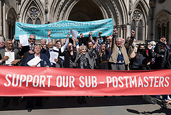 © Licensed to London News Pictures. 23/04/2021. London, UK. Former Post Office sub-postmasters react to the verdict outside The High Court. The Appeal Court has cleared the names of a group of 42 sub-postmasters - some of whom were jailed for stealing money after the Horizon accounting software was installed at Post Offices. At a previous High Court hearing a judge found the Fujitsu accounting system had major faults and defects. The Post Office has already agreed to pay £58m in a settlement with more than 500 sub-postmasters. <br /> Six convictions were overturned last year . Photo credit: Peter Macdiarmid/LNP
