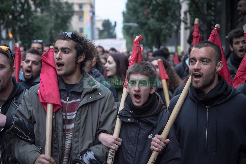 November 17, 2018 - Athens, Greece - Protesters are seen holding flags while shouting slogans during the protest..Thousands of people have demonstrated during the 45th anniversary of the Polytechnic uprising against the military junta in 1973. (Credit Image: © Nikolas Joao Kokovlis/SOPA Images via ZUMA Wire)