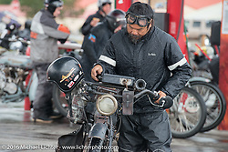 Shinya Kimura on his 1915 Indian at a rainy gas stop during the Motorcycle Cannonball Race of the Century. Stage-11 ride from Durango, CO to Page, AZ. USA. Wednesday September 21, 2016. Photography ©2016 Michael Lichter.