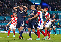 Scotland's Scott McKenna (left) reacts after a missed chance during the UEFA Euro 2020 Group D match at Hampden Park, Glasgow. Picture date: Tuesday June 22, 2021.
