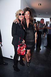 Left to right, AMANDA ELIASCH and HEATHER KERZNER at a private view of photographs by David Bailey entitled 'Then' held at Hamiltons, 13 Carlos Place, London W1 on 6th July 2010.