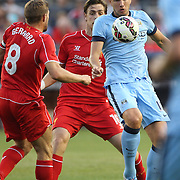 Edin Dzeko, (right), Manchester City, is challenged by Steven Gerrard, Liverpool, during the Manchester City Vs Liverpool FC Guinness International Champions Cup match at Yankee Stadium, The Bronx, New York, USA. 30th July 2014. Photo Tim Clayton