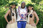 KO OLINA - FEBRUARY 11:  NFC New York Giants 2005 NFL Pro Bowl All-Stars Tiki Barber #21 poses with Hawaiian Hula girls for his 2005 NFL Pro Bowl team photo on February 11, 2005 in Ko Olina, Hawaii. ©Paul Anthony Spinelli