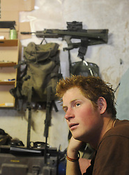 Prince Harry relaxes on his camp bed at FOB Delhi (forward operating base) while posted in Helmand Province in Southern Afghanistan.