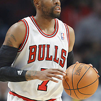 26 March 2012: Chicago Bulls point guard C.J. Watson (7) brings the ball upcourt during the Denver Nuggets 108-91 victory over the Chicago Bulls at the United Center, Chicago, Illinois, USA. NOTE TO USER: User expressly acknowledges and agrees that, by downloading and or using this photograph, User is consenting to the terms and conditions of the Getty Images License Agreement. Mandatory Credit: 2012 NBAE (Photo by Chris Elise/NBAE via Getty Images)