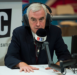 © Licensed to London News Pictures. 28/09/2015. Brighton, UK. Shadow chancellor JOHN MCDONNELL during a radio interview on the morning of Day two of the 2015 Labour Party Conference, held at the Brighton Centre in Brighton, East Sussex. This years conference takes place just weeks after Jeremy Corbyn was elected leader of the party. Photo credit: Ben Cawthra/LNP