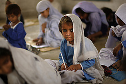Uzma Ijaz, 4, learns how to write her ABC's at the school created by Mukhtar Mai, Meerwala, Pakistan, April 29, 2005. Mai, 33, went against the Pakistani tradition of committing suicide when she brought charges against the men who gang raped her nearly three years ago. With money from the ruling she opened two schools, one for girls, the other for boys, citing that education is the only thing that will stop such acts from happening.