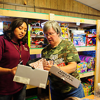 111913  Adron Gardner/Independent<br /> <br /> Volunteers Ursula Johnson, left, and Beverly Benge look over a box of shoes for the Eastern Navajo Child Drive in Bluewater Tuesday.