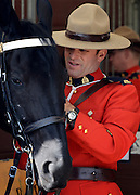 © Licensed to London News Pictures. 11/05/2012. Windsor, UK The Royal Canadian Mounted Police, who are at the show for the Jubilee Pagent, prepare to exercise their horses along the River Thames. The Royal Windsor Horse Show in Windsor, England on May 11 2012. Photo credit : Stephen Simpson/LNP