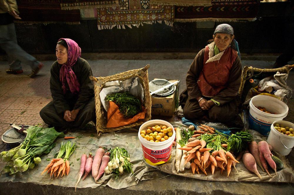 Women selling vegetables along Leh's main bazaar during the Ladakh Festival, Ladakh, India