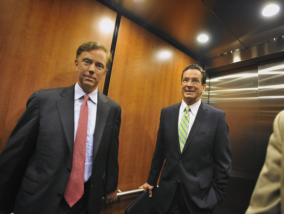 Democratic candidates for governor Ned Lamont, left, and Dan Malloy right, ride an elevator together prior to their live televised debate in West Hartford, Conn., on Tuesday, June 22, 2010.   (AP Photo/Jessica Hill)