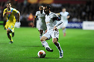 Leon Britton of Swansea city in action. UEFA Europa league match , Swansea city v Napoli at the Liberty Stadium in Swansea, South Wales on Thursday 20th Feb 2014. pic by Andrew Orchard, Andrew Orchard sports photography.