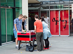 Staff from advertising company Ogilvy playing table football outside office in Medienhafen in Dusseldorf Germany