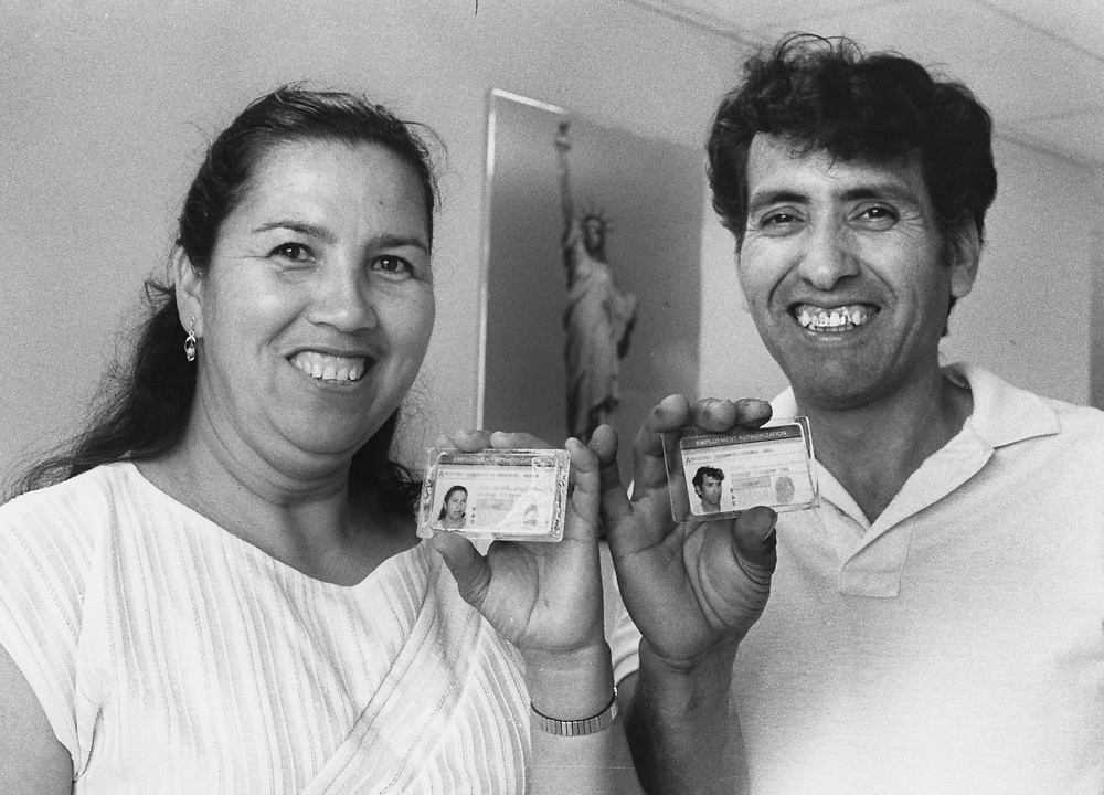 ©1990 Undocumented immigrants at the Austin Immigration and Naturalization (INS) Legalization Center apply for amnesty applications along with the help of an immigration attorney.