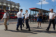 Two men argue as other commuters walk southwards over London Bridge, from the City of London - the capital's financial district - to Southwark on the south bank, on 2nd August 2018, in London, England.