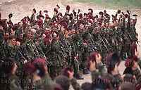Soldiers of the British Parachute Regiment cheering the Queen who was present for inspection. Note the newly in service SA80 rifle. seen May 1990, photograph by Terry Fincher.