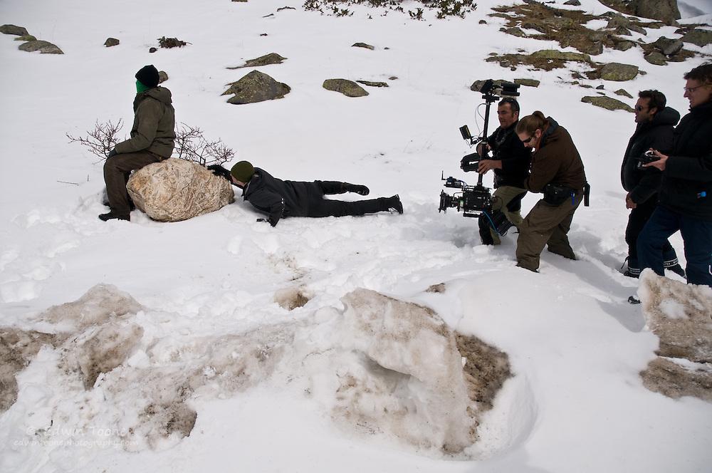 The steadicam operator follow the actor Trond Espen Seim as he crawls through the snow.