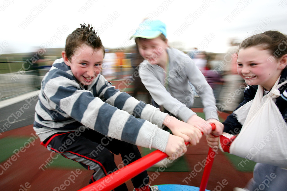 Dean Fitzgerald, Louise Browne and Aleisha Malone try out the rides at the Official opening of the Patty Murphy-Christensen Memorial Playground at Corofin on Easter Monday.<br /> <br /> Photograph  by Eamon Ward