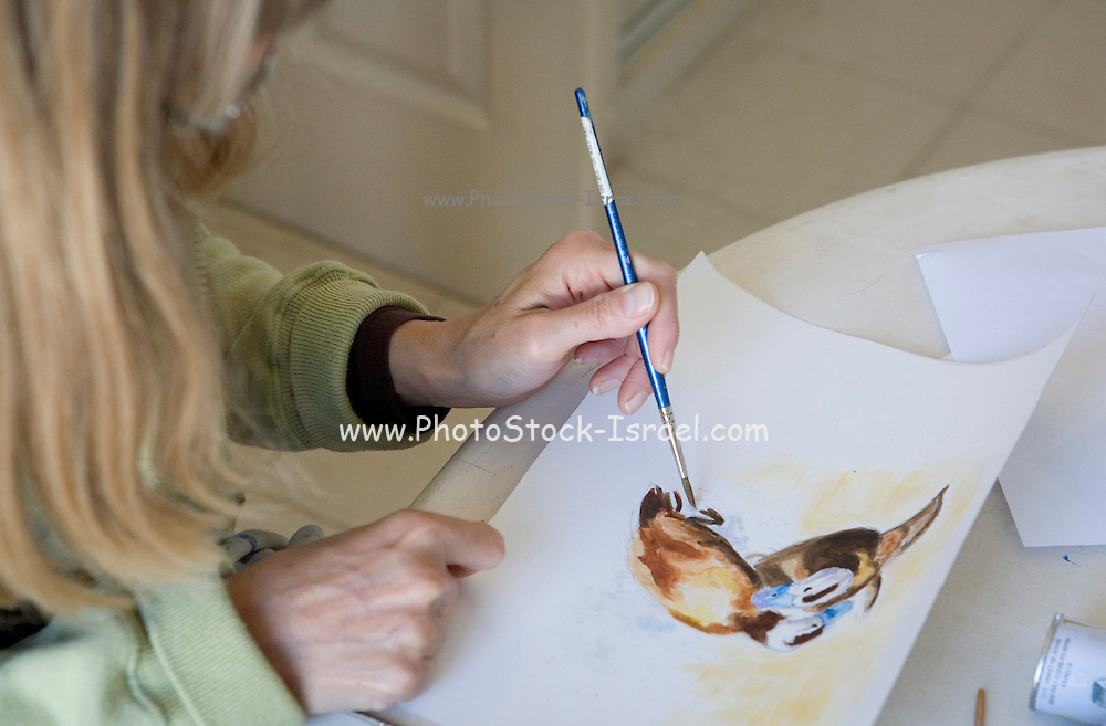 female Artist at work in her studio