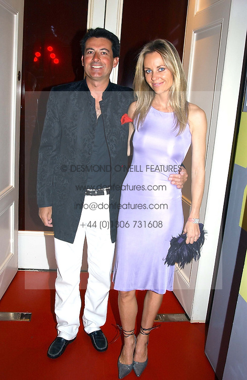 MR NICK BARHAM and SABINA MCTAGGART? at the 60th birthday party for Chris Wright held at Sketch, Conduit Street, London W1 on 7th September 2004.