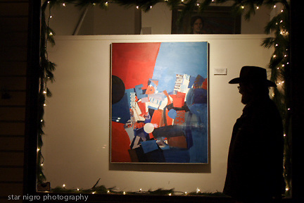 """about photo: artist Anthony Krauss in front of his art at Fletcher's Gallery in the hamlet.<br /> <br /> Story series """"Woodstock,NY """" colony of the arts"""" by Star Nigro.<br /> <br /> This small town is considered one of the most famous towns with a rich history.<br /> <br /> Born and raised in Woodstock, NY, I have been greatly influenced unknowingly as a photographer/ artist surrounded by artists & musicians.<br />  <br /> The elder historians of the community have sparked my intrigue to share this unique towns people, local scenes & way of life.<br /> <br /> <br /> photo by Star Nigro<br /> <br /> ©2021 All artwork is the property of STAR NIGRO.  Reproduction is strictly prohibited.<br /> <br /> starnigro.com"""