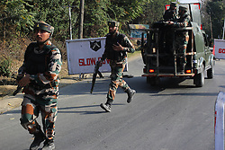 October 3, 2016 - Srinagar, Jammu and Kashmir, India - Indian troopers rushing towards the base camp which was attacked by suspected militants at Baramulla on Oct 03 Indian controlled Kashmir. Suspected militants attacked an Indian army camp in the Indian portion of Kashmir ensuing a gunfight on late evening on Sunday, which ended in the wee hours of Monday morning, police said. (Credit Image: © Umer Asif/Pacific Press via ZUMA Wire)