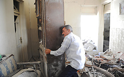 (170729) -- ALEPPO (SYRIA), July 29, 2017 (Xinhua) -- Muhammad Deeb, 65, moves aside a cupboard in his shattered home in Ansari neighborhood, east of Aleppo city, northern Syria, July 28, 2017. The rebels had stayed in the east of Aleppo for five years before they evacuated in December of 2016. Seven months after the Syrian army took full control over the city, life starts to beat again through devastation and destruction in the area. (Xinhua/Ammar Safarjalani) (zjy) (Photo by Xinhua/Sipa USA)