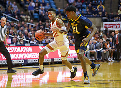 Feb 9, 2019; Morgantown, WV, USA; Texas Longhorns guard Kerwin Roach II (12) drives while defended by West Virginia Mountaineers forward Wesley Harris (21) during the first half at WVU Coliseum. Mandatory Credit: Ben Queen-USA TODAY Sports