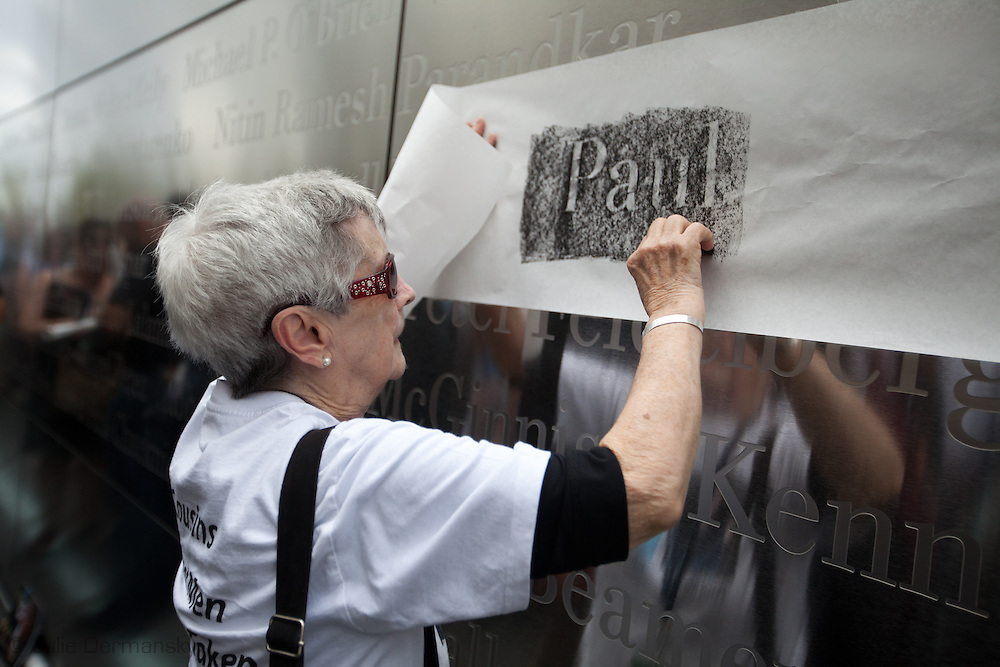 Family members of those lost in the World Trade Center take a first walk through the Empty Sky Memorial 9/11 at Liberty State Park in New Jersey   on September 10th 2011  just before  the tenth anniversary of 9/11. They use<br />  charcoal and paper are provided by volunteers to  make rubbings of the name of their lost loved one. <br /> The memorial is two 30-Ft rectangular towers  208 feet by 10 inches long,  the width of the World Trade Center towers and with the names of the 746 New Jerseyans who perished after the terrorist attacks on 9/11, 2001  etched in stainless steel.